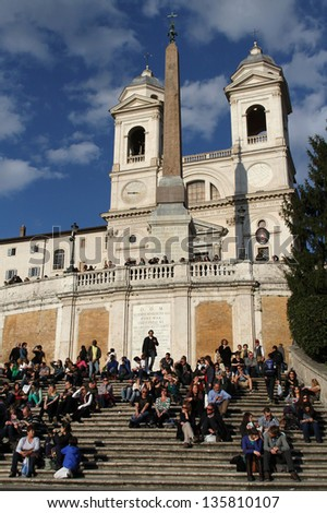 ROME, ITALY - APRIL 3 :  Young people use to meet on the stairway of Trinita dei Montei, in Rome, Italy, on April 3, 2013. Piazza di Spagna is one of the most famous place in Rome.