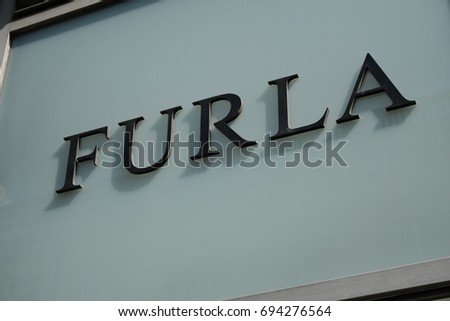 Rome, Italy - August 9, 2017: Furla store signage. Furla is an Italian luxury company that was created by the Furlanetto family in 1927. The company is currently a limited liability company