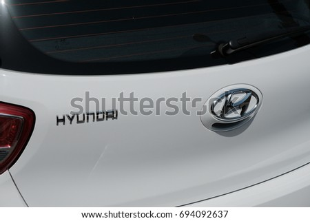 Rome, Italy - August 9, 2017: Hyundai logo on white car. The Hyundai Motor Company is a South Korean multinational automotive manufacturer