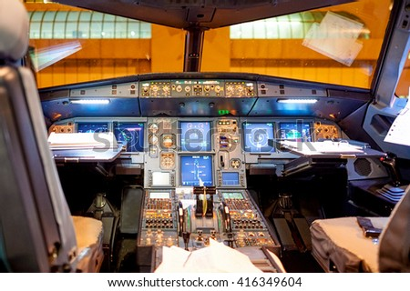 ROME, ITALY - AUGUST 04, 2015: inside of Airbus A320 cockpit. The Airbus A320 family consists of short- to medium-range, narrow-body, commercial passenger twin-engine jet airliners. - stock photo