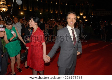 "ROME, ITALY - AUGUST 9, 2011: Italian actor Roberto Benigni during the filming of the movie ""To Rome with Love"", directed by Woody Allen. The actor on the scene of the movie with actress Monica Nappo. - stock photo"