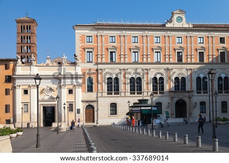 Rome, Italy - August 8, 2015: Piazza di San Silvestro, street view with walking tourists and Church of Saint Sylvester the First on a background - stock photo