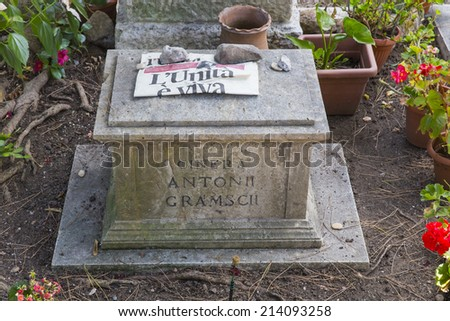ROME, ITALY - AUGUST 19, 2014: someone filed the latest issue of the communist newspaper L'Unita on the tomb of Antonio Gramsci - stock photo