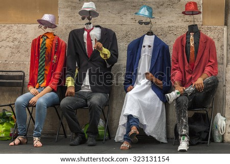 ROME, ITALY - AUGUST 1 2015: The Invisible Men street performers are gaining popularity on the streets of Rome, Italy. - stock photo