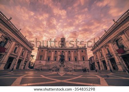 Rome, Italy: beautiful spectacular winter sunrise in the Capitoline Hill, Latin: Collis Capitolinus, Italian: Campidoglio, in the sunrise. Capitolium square, Italian: Piazza del Campidoglio.  - stock photo