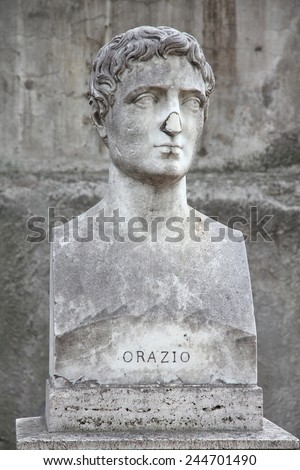 Rome, Italy. Bust statue of Horace, famous Roman lyric poet. Sculpture in Villa Borghese park. - stock photo
