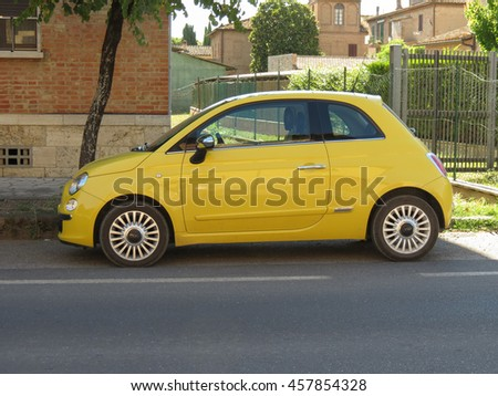 ROME, ITALY - CIRCA JULY 2016: yellow Fiat New 500 car parked in a street of the city centre