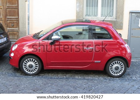 ROME, ITALY - CIRCA OCTOBER 2015: red FIAT 500 car (new version) parked in a street of the city centre