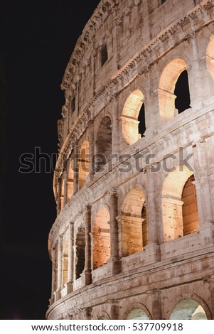 ROME, ITALY - CIRCA OCTOBER 2016: walls of Colosseum at night time in Rome, Italy circa October 2016.