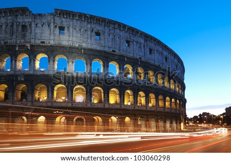 Rome - Italy. Coliseum at night with colorful blurred traffic lights. - stock photo