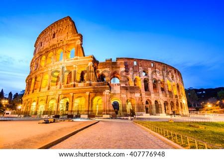 Rome, Italy. Colosseum, symbol of the ancient city. Flavian Amphitheatre in illuminated twilight. - stock photo