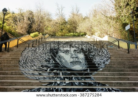 ROME, ITALY - DECEMBER 12, 2015: The work of the Italian street artist David Diava   Vecchiato on the stairs in via Ugo Bassi