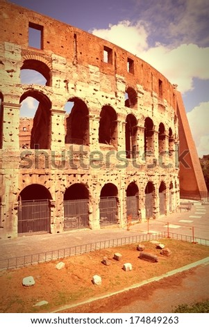 Rome, Italy. Famous Colosseum, Flavian Amphitheatre. Ancient landmark. Retro color tone - cross processing image style.