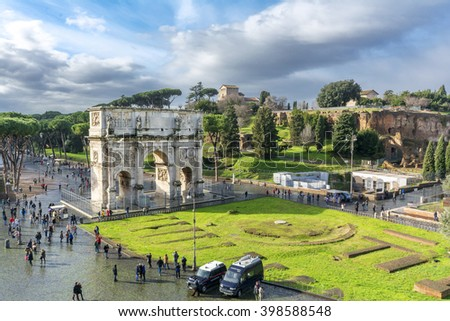 Rome, Italy - February 04, 2015 : People are visiting Colosseum and Arch of Constantine. Colosseum the most well-known and remarkable landmark of Rome and Italy - stock photo