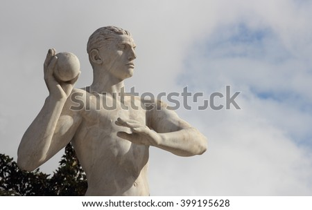 ROME, ITALY - FEBRUARY 9, 2016:  Weight throw Statue in the Stadio dei Marmi , Stadium of the Marbles in the Foro Italico designed in the 1920s by Enrico Del Debbio