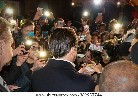 "Rome, Italy - January 15, 2016: Actor Leonardo DiCaprio arrives in Rome leg of a European tour to promote his latest film, ""The Revenant"". Italian fans welcome him with enthusiasm. - stock photo"