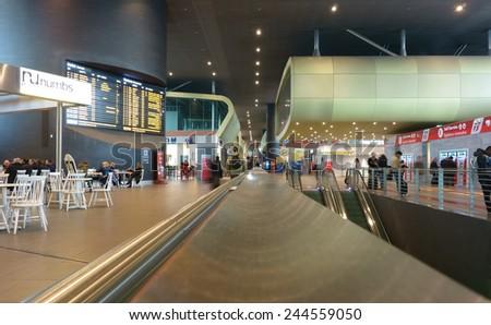 ROME, ITALY - JANUARY 8, 2014: people in the modern Tiburtina Railway station interior - stock photo