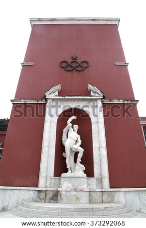 ROME, ITALY - 30 JANUARY 2016: Statue of athlete in Stadio dei Marmi, inside the Foro Italico a sport complex. In the background the headquarters of Italian Olympic Committee aka CONI, in Rome Italy - stock photo