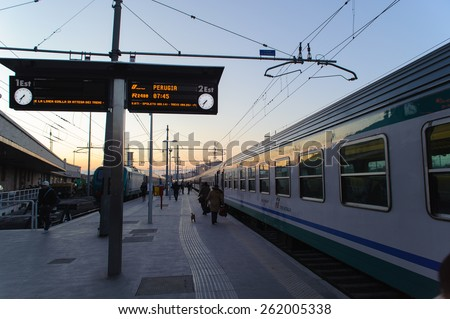 ROME, ITALY - JANUARY 23, 2010: View of outdoor train platform at Termini Station in the morning. The destination of train at this platform is the Perugia. - stock photo