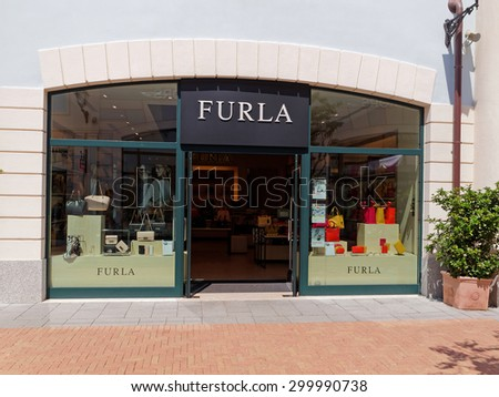 ROME, ITALY - JULY 25, 2015. Furla Store in Rome, Italy. Furla features Italian designed products that range from handbags and shoes to accessories. Its headquarters are located in Bologna.