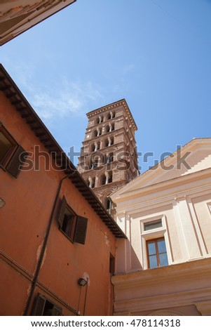Rome, Italy - July 10, 2016: Piazza di San Silvestro, street view with walking tourists and Church of Saint Sylvester the First on a background