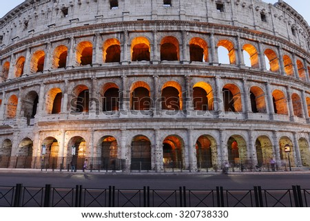 ROME, ITALY - JULY 17:  The famous ancient Roman Colosseum structure illuminated during dusk on July 17, 2015, Rome, Italy. It is the largest amphitheater ever built  of concrete and stone