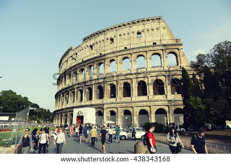 ROME ITALY  : 14 JULY 2013 Tourist come to see biggest Colosseum or coliseum  in rome italy and cross process and soft flare filter - stock photo