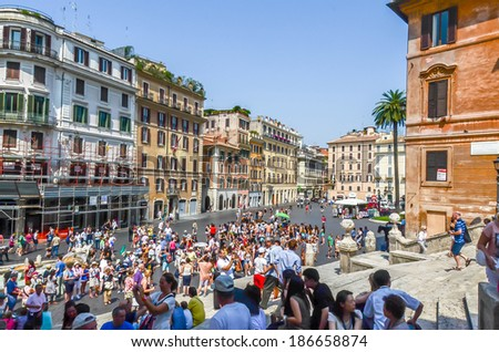 Rome, Italy - July 12, 2013. Tourists visits Piazza Spagna