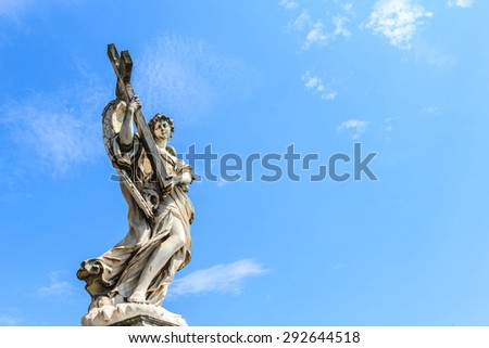 ROME, ITALY- JUNE 20: Angel with the Cross statue is located on the Ponte Sant'Angelo bridge in front of the Castel Sant'Angelo, Rome, Italy on June 20, 2015. - stock photo