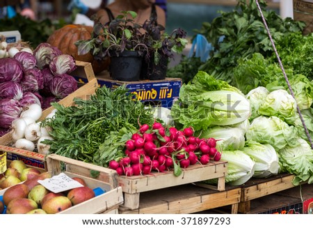 ROME, ITALY - JUNE 15, 2015: Fresh fruits and vegetables for sale in Campo de Fiori, famous outdoor market in central Rome.