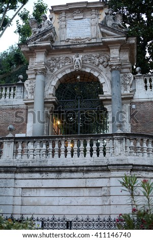 ROME, ITALY - JUNE 11, 2015: Old gate near Piazza Quirinale in Rome. Italy - stock photo