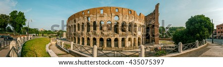 ROME, ITALY - JUNE 11, 2016: Panoramic view to the most visited monument of the world, the Colosseum (west side), shot in a wide angle format on a sunny morning
