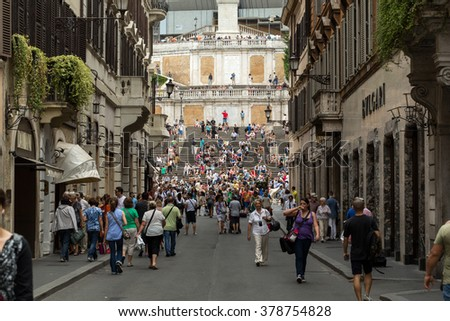 ROME, ITALY - JUNE 15, 2015: Spanish Steps and Via Condotti in Rome. This street is the center of fashion shopping in Rome with the atelier of Bulgari, Armani, Cartier, Fendi, Gucci, Prada and others