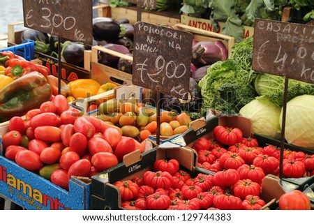 ROME, ITALY - JUNE 3 : Tomatoes for sale at one of the increasingly popular traditional food markets on 3 June 2011 in Rome. The vegetables originate from small scale producers around Rome.