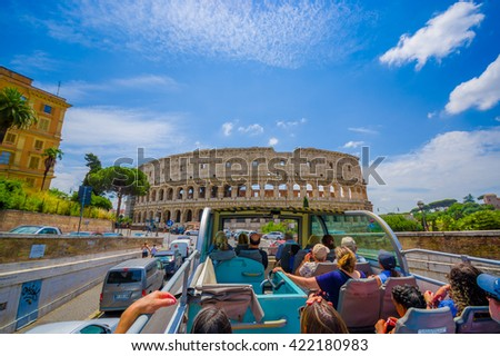 ROME, ITALY - JUNE 13, 2015: Turists bus visiting the most important places in Rome city, people watching from their seats.