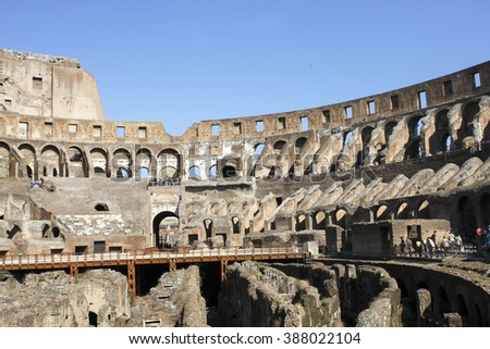 ROME, ITALY- JUNE 2, 2012: Unidentified people by Colloseum in Rome. It is most remarkable landmark of Rome and Italy. The Colosseum is an elliptical amphitheatre in the centre of the city of Rome. - stock photo