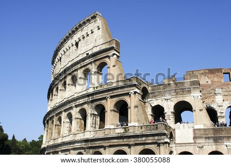 ROME, ITALY- JUNE 2, 2012: Unidentified people by Colloseum in Rome, Italy. It is most remarkable landmark of Rome and Italy. Colosseum is an elliptical amphitheatre in the centre of the city of Rome. - stock photo