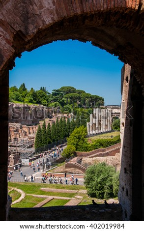 ROME, ITALY - JUNE, 6: View through an arch of the Colosseum on the Sacred road on 6 june 2012 - stock photo