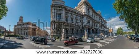 ROME, ITALY - JUNE 6, 2016: Wide-angle panorama with Casa Madre dei Mutilati fascist building, The Palace of Justice, so-called Palazzaccio, and the everyday traffic surrounding it.