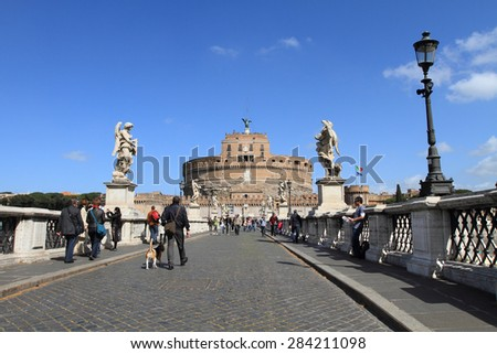 ROME, ITALY - MARCH 12, 2009: Castle Saint Angelo and bridge on March 12, 2009 in Rome, Italy. The medieval castle and bridge is a landmark in Italy. - stock photo