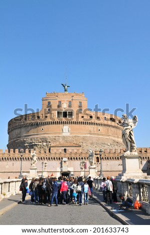 ROME, ITALY - MARCH 28, 2011: Group of tourists visiting Sant Angelo castle, major touristc attraction in Rome