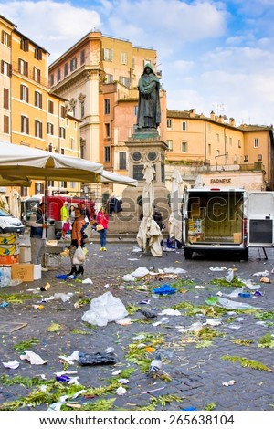 ROME, ITALY - MARCH 21, 2015: Piazza Campo de Fiori and Giordano Bruno statue in March 21, 2015  in Rome Italy. The trash made after the flower market that took place in the square - stock photo