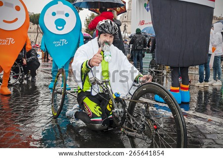 Rome, Italy - March 22, 2015: 21th Rome Marathon, the handbike race was won by Italian Fabrizio Caselli, soon after his arrival at the finish line. - stock photo