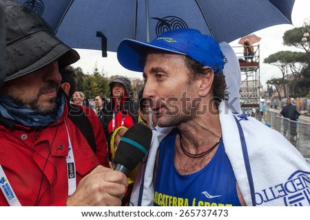Rome, Italy - March 22, 2015: the Italian Giorgio Calcaterra releases the first interview right after the first race. Afterwards start again deep in my group for his second marathon.