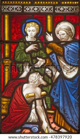 ROME, ITALY - MARCH 9. 2016: The Saints Peter and John Healing the Lame Man on the stained glass of All Saints' Anglican Church by workroom Clayton and Hall (19. cent.)