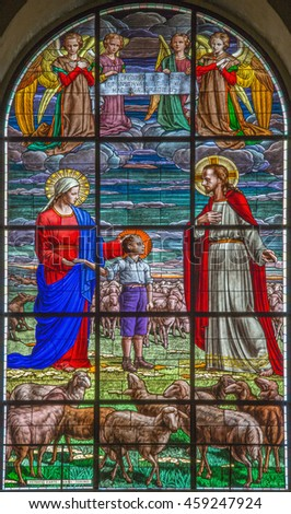 ROME, ITALY - MARCH 10, 2016: The scene of The dream od Don Bosco at the age of nine (1825) in the stained glass of church Basilica di Santa Maria Ausiliatrice by Janni Torino (20. cent.)