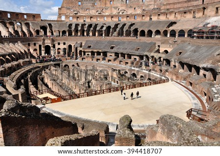 ROME, ITALY - MARCH 15, 2016: Tourists visiting the interior of the Colosseum, one of the New Seven Wonders of the World