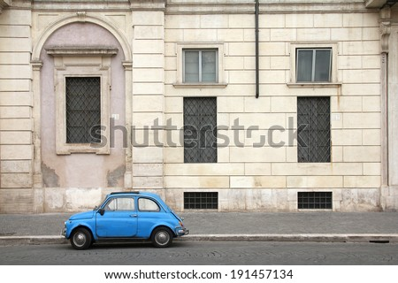 ROME, ITALY - MAY 12, 2010: Fiat 500 parked in Rome, Italy. With almost 4 million units sold, Fiat 500 is among Top 50 cars in automotive history. Nowadays it is desired by collectors. - stock photo