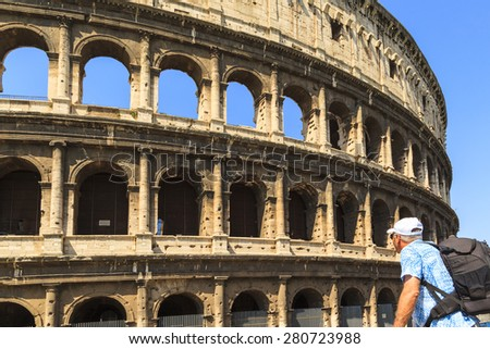 ROME ITALY - MAY 21, 2014 - Tourist marvels  the Colosseum in Rome. The Colosseum is an iconic symbol of Imperial Rome. In 2007 it was included among the New7Wonders of the World - stock photo