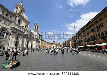 ROME, ITALY - MAY 21, 2014 - tourists in piazza navona